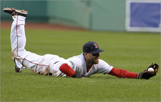 Second baseman Dustin Pedroia made a diving catch of Robert Andino's blooper in shallow right field to end the top of the 16th inning.