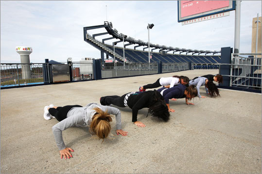 Cheerleaders do pushups after every ramp level they run.