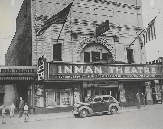 Inman Theatre It wasn't a large theater, but it was a common place for locals to go for a cheap matinee on Saturdays. The Theatre (now the East Cambridge Savings Bank) got movies a little later than other Boston houses. 'They used to have girl ushers, real tough girls. They'd go around with a flashlight, and if they saw a little kid in one chair, they'd flash the light, and say, 'Come on in there, two in a seat.' Then the kid would have to move, two in a seat, to fill up the place,' said Mary McKenna in the book, 'From the Heart of Cambridge.' The Inman Theatre, photographed in the 1930s, was located at 1318 Cambridge St.