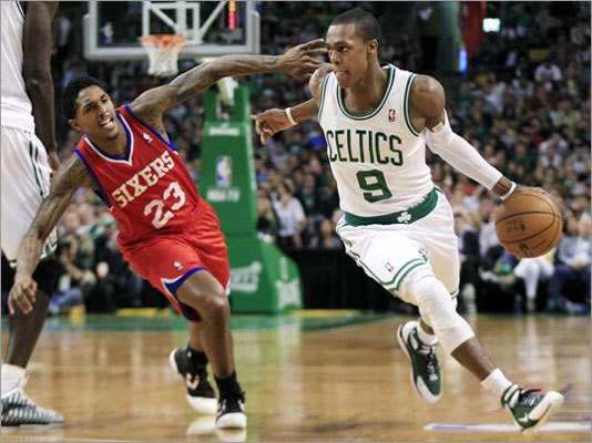 Rajon Rondo (right) drove by 76ers guard Lou Williams (23) during the first quarter of Game 1.