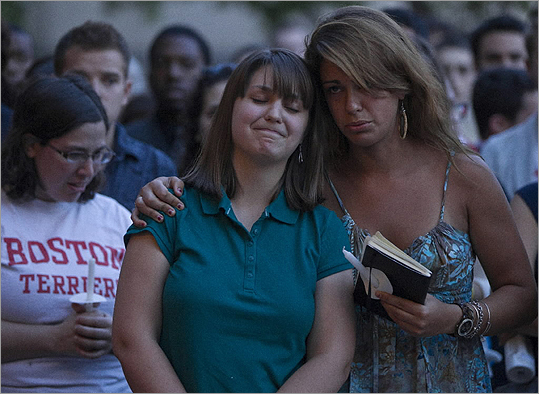 Boston University student organizer Katie Matthews got a hug from Tori Pinheiro (girlfriend to Austin Brushears, one of the deceased) during a candlelight vigil on campus in Marsh Plaza for the students involved in the fatal car accident in New Zealand on May 12.