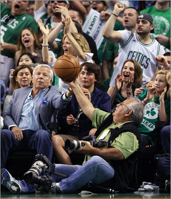 After the Celtics' Paul Pierce (not pictured) rejected a 76er shot in the second quarter, fans cheered, and when the blocked basketball headed into the seats, New England Patriots owner Robert Kraft reached for it, but a courtside photographer beat him to it.