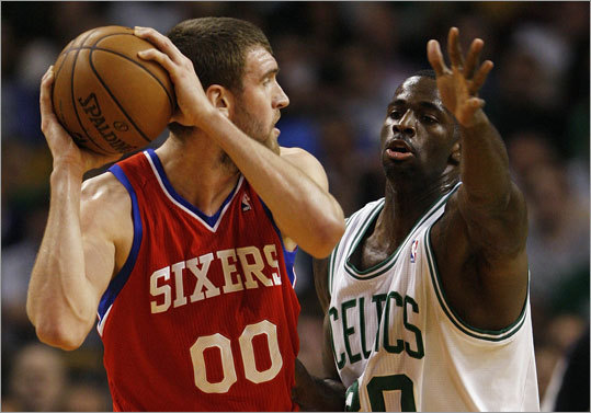 Brandon Bass (right) guarded Spencer Hawes during the first half of Game 1.