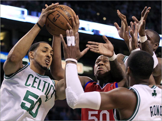 Ryan Hollins (left) controlled a loose ball against Lavoy Allen as Celtics Rajon Rondo and Mickael Pietrus (far right) also bid for the ball also during the third quarter.