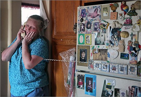 Terri Killam took calls from relatives as she waited for word about her niece, Margaret Theriault.