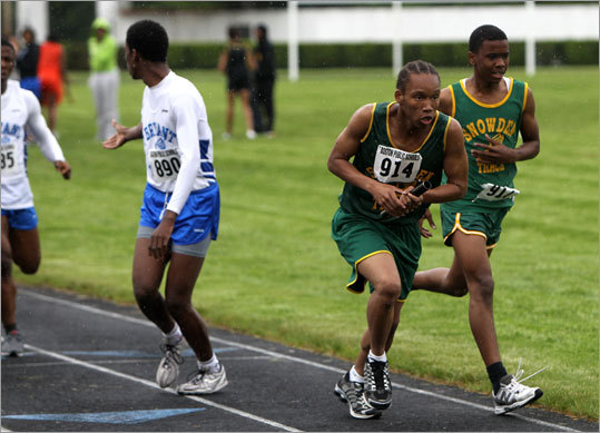 Snowden International's Victor Harris, No. 914, took the handoff as O'Bryant's Patrick Powell, No. 890, at left waits for the baton in the boys 4X400 relay. O'Bryant won the race and Snowden took second place.