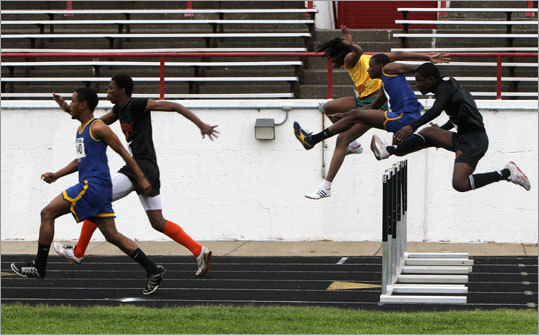 Runners clear the hurdles in the boys 110-meter high hurdles. The race was won by East Boston's Orlandino Gray.