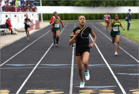 Latin Academy's Ashley Lewis, No. 729, crossed the finish line to win the girls 400 at White Stadium.