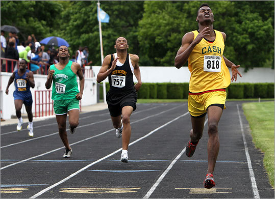 Andy Pierre, No. 818, a senior at Community Academy of Science and Health, won the boys 400 in the city boys and girls track championships at White Stadium.