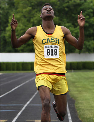 CASH's Andy Pierre pointed skyward after winning the boys 400.