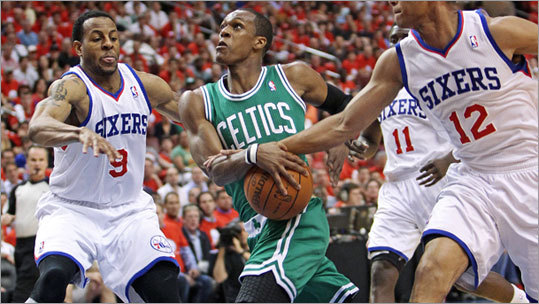 Rajon Rondo and the Celtics raced to the lead over Andre Iguodala (left), Evan Turner and the Sixers. After trailing 33-28 in the first quarter, the Celtics outscored the Sixers 32-16 in the second to take a commanding lead.