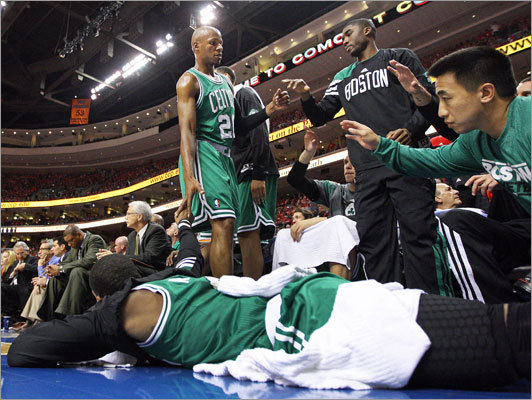 As he left the game, the Celtics' Ray Allen got a hand from Rajon Rondo, who was laying on the floor stretching in the second quarter.