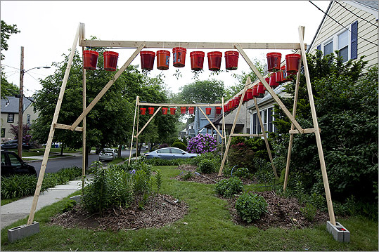"Newton city officials had warned Eli Katzoff - the creative force behind the 13-foot tall hanging tomato garden - that he had to start removing the structure from his front yard near Route 9 by Friday. Late on Thursday, Katzoff landed a new home for his garden: the Andover Newton Theological School. ""We wanted to find something that really worked for us,"" Katzoff said. ""It's in a place that's very safe."""
