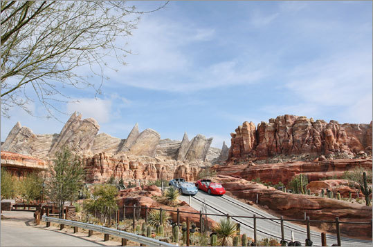 In this 2012 image released by Disney theme parks, Radiator Springs Racers are shown at Cars Land, a new attraction based on the Disney-Pixar animated series 'Cars,' at Disney California Adventure park in Anaheim, Calif. Cars Land features three family attractions showcasing characters and settings from the film.