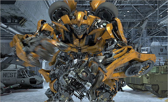 At left, The character Bumblebee from the 'Transformers the Ride: 3D,' attraction at Universal Studios Hollywood in Los Angeles. Debuting May 25 at Universal Studios Hollywood, the ride, based on the film franchise, offers motion-simulator vehicles and 3D high definition video. The ride opens this weekend and is just one of a number of new attractions coming to theme parks across the country this season.
