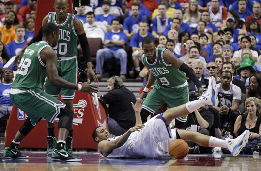 The 76ers' Evan Turner (bottom) lost the ball and his footing as Celtics Mickael Pietrus, Ray Allen and Rajon Rondo (from left) watched the play.