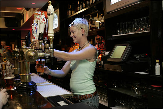 The Independent Crys McDonald, a bartender at The Independent, drew a beer while working Monday night in 2011.