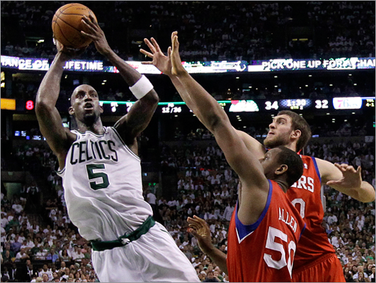 Kevin Garnett shot against 76ers forward Lavoy Allen and center Spencer Hawes during the second quarter.