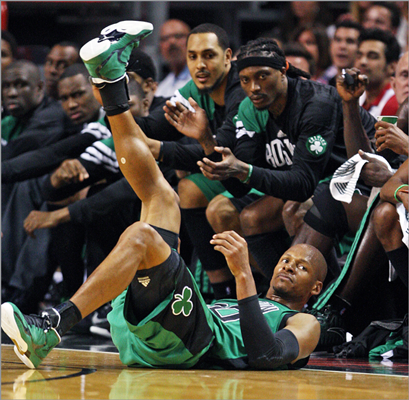Ray Allen hit the floor after he was fouled in the act of taking a 3-pointer in the second quarter in front of Boston's bench.