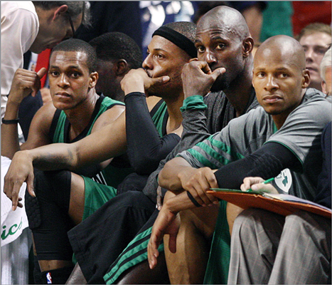 With the outcome of the game no longer in question, Celtics starters (left to right) Rajon Rondo, Paul Pierce, Kevin Garnett, and Ray Allen watched the end of the game from a sad looking bench.