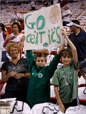 Fans of the Boston Celtics held up a sign in support of the Celtics.