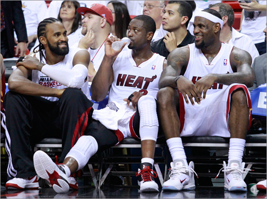 The Heat's Ronny Turiaf, Dwyane Wade and LeBron James reacted as they sit on the bench late in the fourth quarter during Miami's team's 93-79 win over the Celtics in Game 1 of the Eastern Conference Finals in Florida. The Heat took a 1-0 lead.