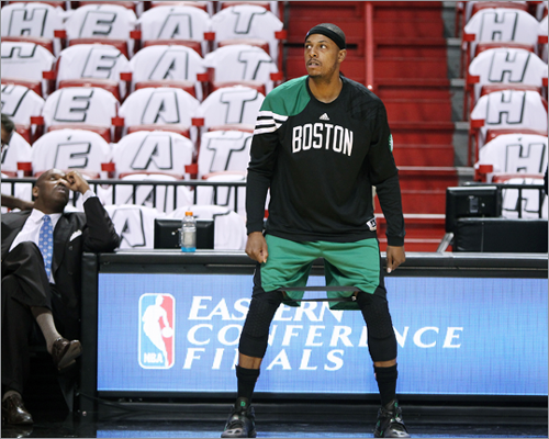 Celtics captain Paul Pierce used an elastic band around his legs as he got loose before the game.
