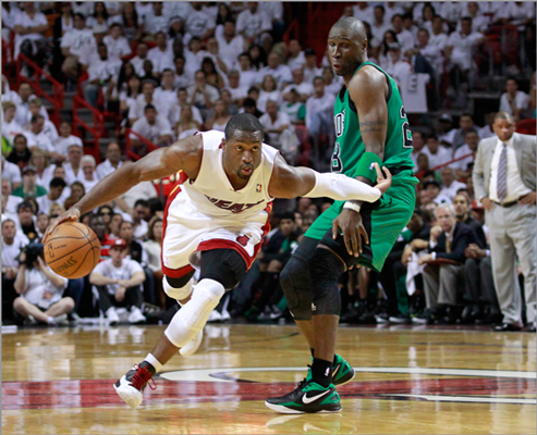 Dwyane Wade drove past the Celtics' Mickael Pietrus in the second quarter.
