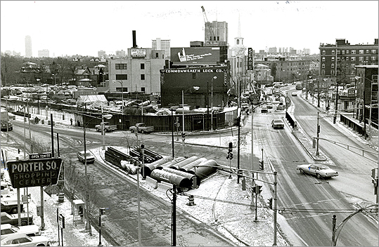 Porter Square grew and began redeveloping after the construction of the Red Line stop in 1986. Pictured: Porter Square looking east down Massachusetts Avenue at the construction over MBTA's station.