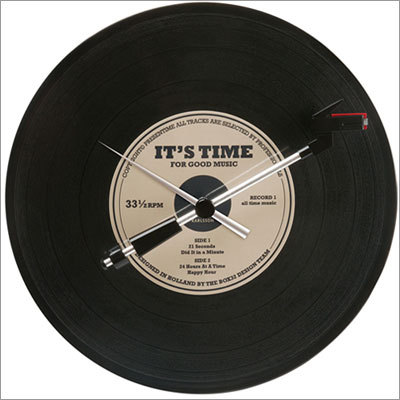 Spinning Record Oldies Wall Clock Price: $89.99 Does your Dad hate iPods, CDs, or all sound systems since the days of records? Let him remember the good old days with this record clock that actually spins.
