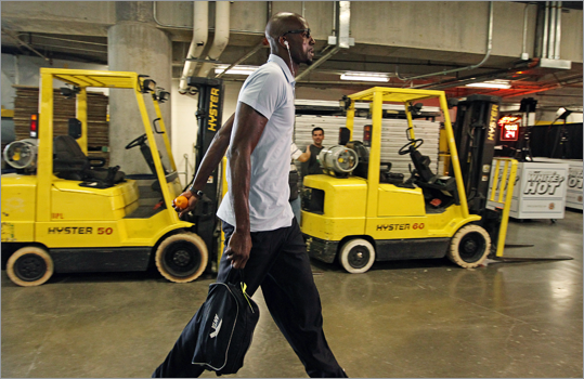 Kevin Garnett headed for the locker room as he arrives at the arena for the game.