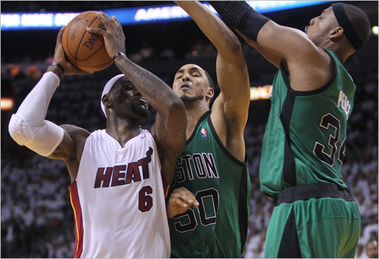 Celtics center Ryan Hollins small forward Paul Pierce doubled down on Heat small forward LeBron James during the second quarter.