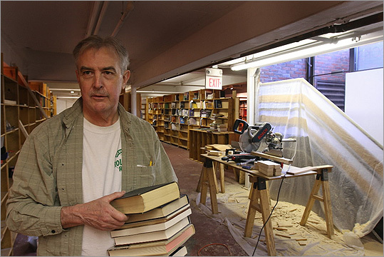 The McIntyre & Moore bookstore closed in 2011 after moving from Davis Square and before that, Harvard Square. Pictured: Co-owner Dan Moore installing shelves and moving in books in 2008.