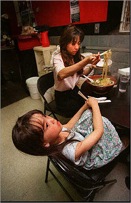 There are great stand-style Japanese and Korean restaurants within the Porter Square Exchange. It's common to find a line to Sapporo Ramen extend down the hallway. Pictured: Ranko Houston filled a bowl of ramen for her daughter, Jessica, 5, at Sapporo Ramen, a noodle restaurant at Porter Square Exchange in 1995.