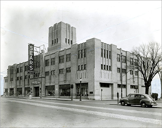 However, the electrified street car introduced a universal $.05 fare to cross Cambridge and led to higher density housing construction to attract second- or third-generation immigrant families from crowded neighborhoods in East Cambridge, Cambridgeport, and Boston. Retail stores flourished. Pictured: The Sears Cambridge store in 1941. Today, the building is known as the Porter Exchange, which houses Lesley University and several Japanese shops and restaurants.