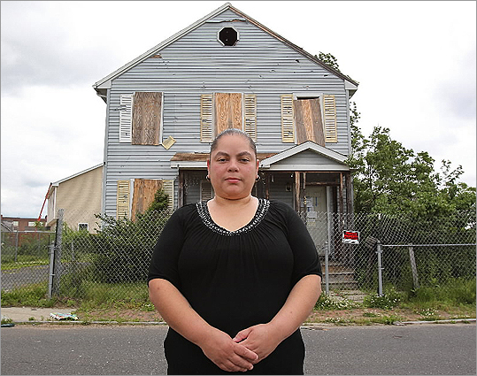 Lillian Santiago, in front of her former home on Spruce Street, Springfield.