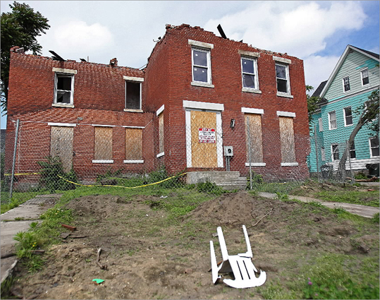 A city-owned building on Hemlock Court in Springfield has yet to be torn down. Neighbors reported seeing kids going into the house and taking bricks.