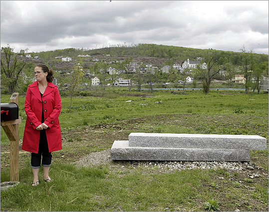 Pia Rogers stood by her front steps, the only part of her house in Monson left intact after a tornado blew through central Massachusetts and devastated her town.