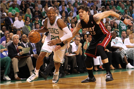Ray Allen drove in the first half against Mike Miller.