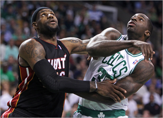 LeBron James and the Celtics Brandon Bass battle under the boards during the first quarter.