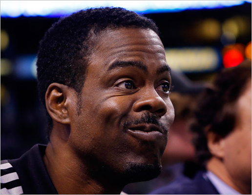 Comedian Chris Rock watched Game 3 courtside.