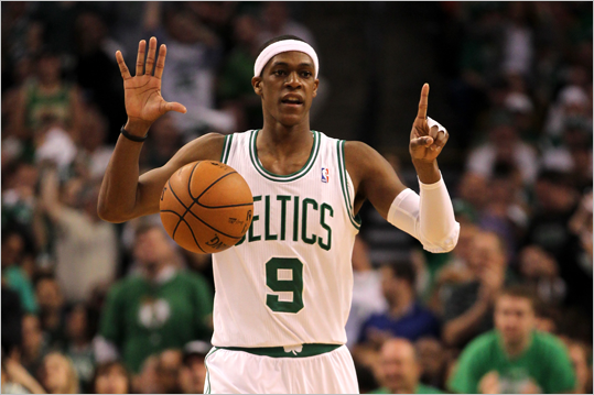 Rajon Rondo called a play as he brings the ball up court.