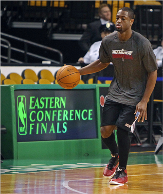 Miami's Dwayne Wade worked on his dribbling before the game.