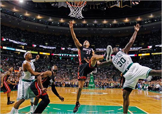 Shane Battier shot past Celtics forward Brandon Bass during the first half.