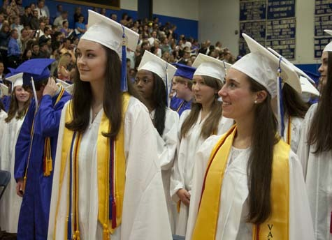 Salutatorian Margaret Reagan (left) and Valedictorian Victoria Machado stand at the start of the ceremony.