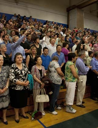 Relatives and other visitors crowded into the stands at Braintree High's gym to escape the rain.