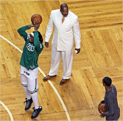 Celtics radio color commentator Cedric Maxwell was in an all white suit as he chatted with Rajon Rondo while Marquis Daniels worked on his shooting at left before the game.