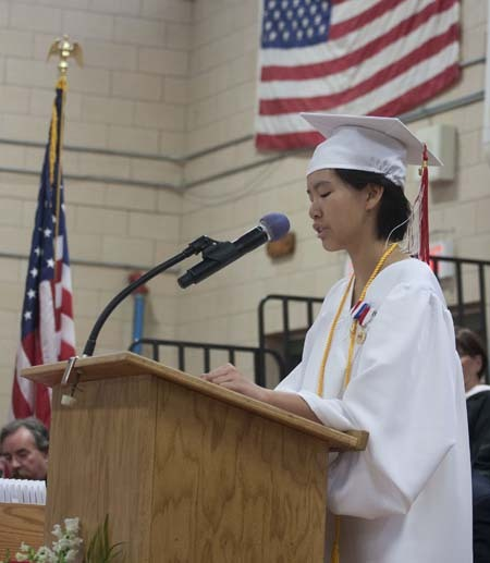 Valedictorian Ariana Kam speaks about the future in her address, which was in rhyme. She will attend Harvard in the fall.