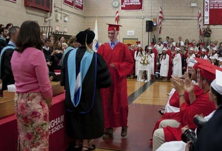 James Joseph Gordon, who has been battling cancer, is given a warm ovation as he receives his diploma.