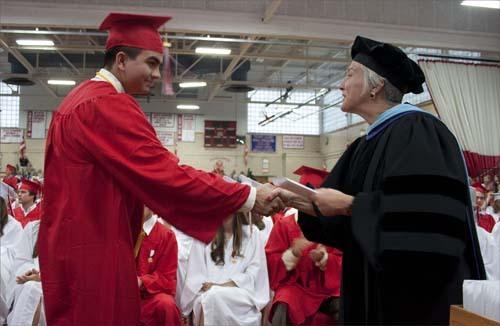 Principal Paula Girouard McCann hands out diplomas.
